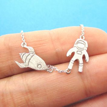Spaceship and Astronaut Space Travel Themed Charm Necklace in Silver | DOTOLY