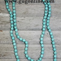 Long Strand of Turquoise Bead Necklace