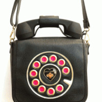 Call me maybe. This super-fun crossbody comes complete with a unique feature ... the removable phone set handle works as a functioning listening device when plugged into your cellphone.