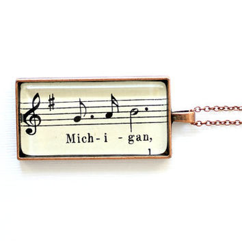 Michigan necklace.  Vintage sheet music jewelry with word michigan and music notes under glass