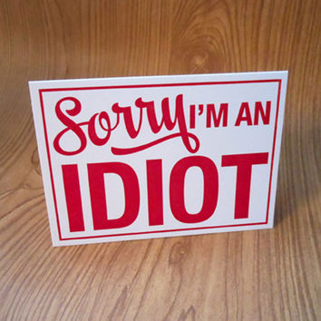 letterpress sorry i'm an idiot sign greeting card red on white with blue envelope