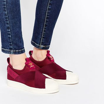 adidas Originals Burgundy Slip On Trainers at asos.com