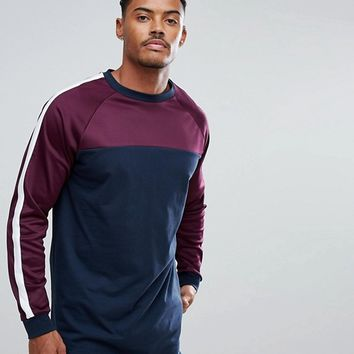 ASOS Super Longline Long Sleeve T-Shirt With Contrast Yoke And Curved Hem at asos.com