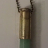 Vintage Green Crystal Bullet Necklace by allthingswildandfree
