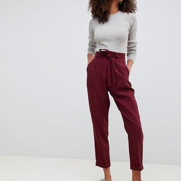 ASOS DESIGN woven peg pants with obi tie at asos.com