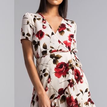 AKIRA Short Sleeve Wrap Front Ruffled Hem Plunging Neckline Floral Print Mini Dress in White