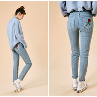 Rose-Appliqué Washed Tapered Jeans