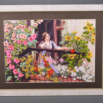 Handmade satin ribbon embroidery with flowers on the canvas in the frame home de