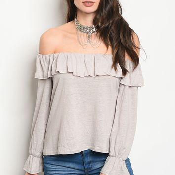 Ladies fashion long sleeve jersey off the shoulder top that features ruffle details