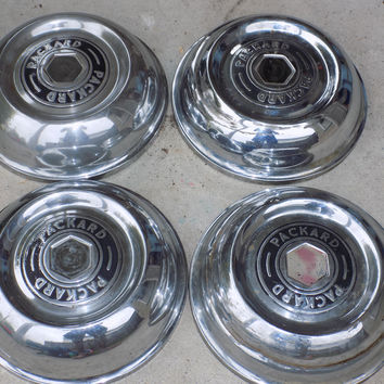 Four Packard Hubcaps (Chrome)