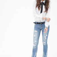 Slim Distressed Low-Rise Jeans
