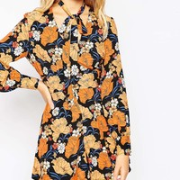 ASOS Woven Playsuit in Retro Floral Print with Pussybow