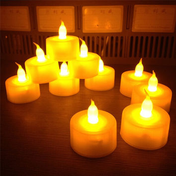 New 12 pcs/lot Flickering Flameless LED Tealight Flicker Tea Candle Light Xmas Party Wedding Candles Safety Home Decoration