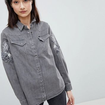 Wrangler Denim Shirt with Eagle Embroidered Sleeves at asos.com