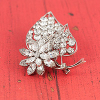 Vintage 1940s clear rhinestone and silver brooch, plated metal flower leaf pin. Sparkly, classy, wedding perfect mid-century costume jewelry