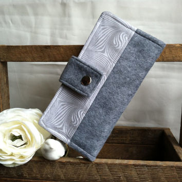 Grey felt womens folded wallet with grey sparkly print in swirls, coin pouch, bill slots, card slots