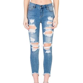 stevie - destroyed light denim wash jeans with frayed hem