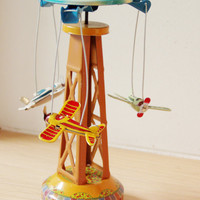 Vintage carnival ride with aeroplanes, retro collectible toy, colourful carnival toy reproduction with lever, early nineties