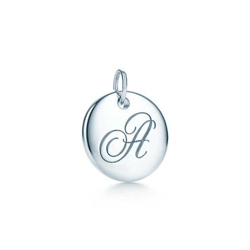 Tiffany & Co. - Tiffany Notes alphabet disc charm in silver, small. Letters A-Z available.