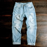 light vintage wash distressed boyfriend jeans