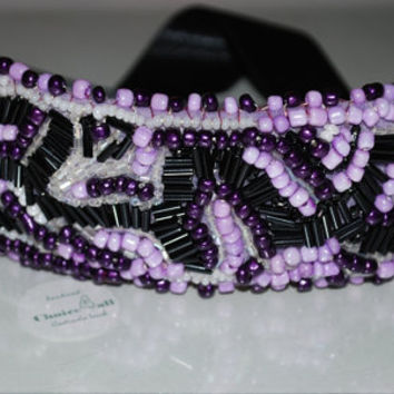 statement bracelet  embroidered on purple felt