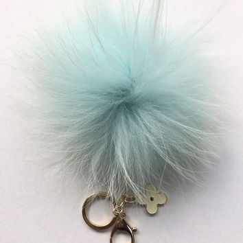 Very Light Blue with natural markings Raccoon Fur Pom Pom luxury bag pendant + black flower clover charm keychain