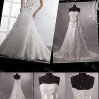 Elegant sweetheart A-line tulle with appliques ruffle wedding dress