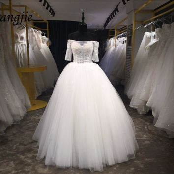 2018 Ball Gown Wedding Dresses Boat Neck Off-Shoulder Half Sleeve Floor Length Tulle and Lace Bridal Dress Gown Robe De Mariage