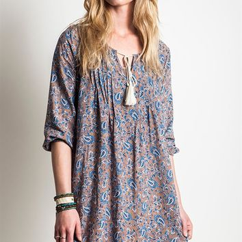 It's a super soft blue color paisley print taupe cotton blended fabrication background, features a flare fitting, three quarter sleeves with elastic trim, paisley pattern print throughout, scoop neckline with V-cutout and tassel self-tie, pin tuck pleated