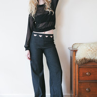 Starlight - wide legged black denim jeans with high waist and cutouts