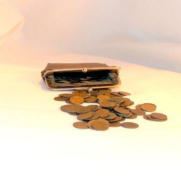 Old purse. Soviet wallet. Soviet coins. Vintage. A purse with coins. Purse for coins. Coins of the USSR. Brown wallet.