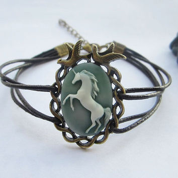Bracelet---antique bronze love birds with blue resin unicorn&brown leather chain