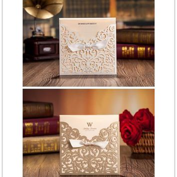 2015 new  50pcs/set free envelop and free seal Elegant Floral laser Cut pocket Wedding Invitation with tie CW5011CW5002