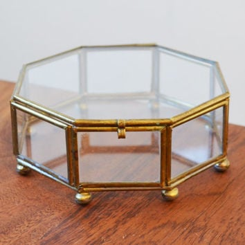 Vintage Brass Curio Trinket Box or display case, lid with latch, glass octagon sides and footed ball feet circa 1970s