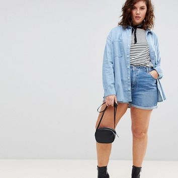 ASOS DESIGN Curve denim mom short in vintage blue at asos.com