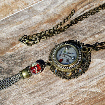 Steampunk Watch Necklace OOAK Artisan Necklace Brass Resin-Filled Charm, Watch Parts, Jewels, Red Lamp work Bead, Silver Tassel