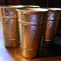 Set of 4 Vintage Mid Century Gold-Tone Aluminum Tumblers with a Hammered Finish