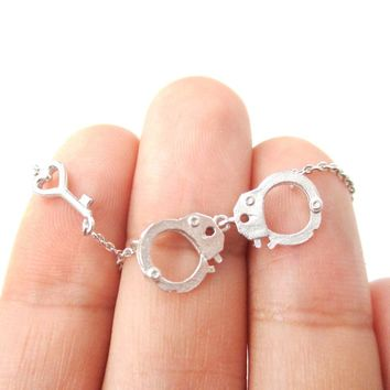 Realistic Handcuff and Heart Shaped Key Charm Necklace in Silver | DOTOLY