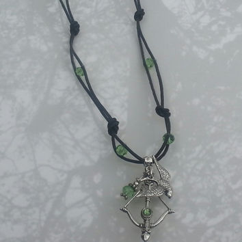 Brown Leather Necklace with green crystal beads, bow and arrow and bird charm