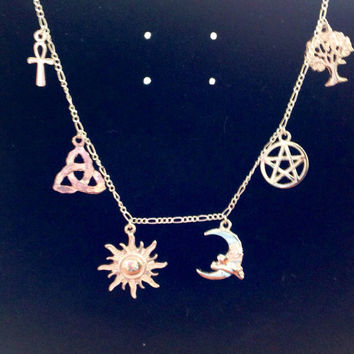 Silver charm necklace with 6 charms ankh,  triquerta, Celtic knot, the sun, the moon, pentagram and the tree of life