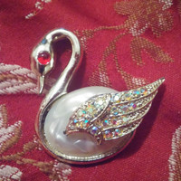 Silver Tone Swan Brooch With Mother of Pearl BodyAurora Borealis Stones on Wings and Ruby Red Eyes