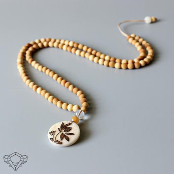 Natural Wood Beaded Mala Necklace & Tagua Nut Hand-Carved Lotus Flower Pendant