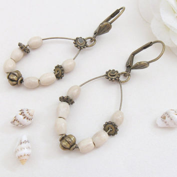 Brass earrings, ivory wooden beads, antiqued bronze beads