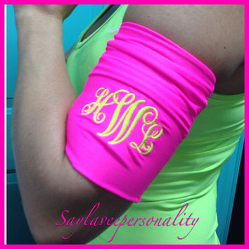 Jogging cell phone and music armband. Stretch monogrammed neon pink fabric to hold cell phone, keys and music
