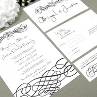 Handwritten Elegance | Modern Wedding Invitation Suite by RunkPock Designs | formal swirl calligraphy script invitation design | shown in classic black and white