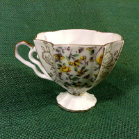 Tea Cup - Very Nice - Elegant - Yellow Floral Design - Unique Handle Style - Unusual Shape