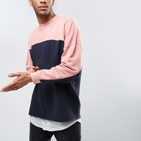 ASOS Oversized Longline Sweatshirt With Cut & Sew at asos.com