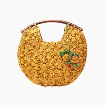Isla Crocheted Raffia Clutch W/ Wooden Handles And Pineapple Charms - Sunflower