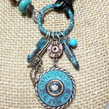 Boho Patina Silver, gold, and copper  turquoise bead crystal Winchester 45 bullet arrow pistol multi-strand black leather cord knot necklace