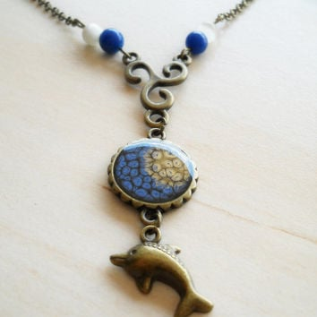Dark blue and golden small round pendant, resin jewelry, antique brass necklace, dolphin charm, jade beads, cat's eye beads